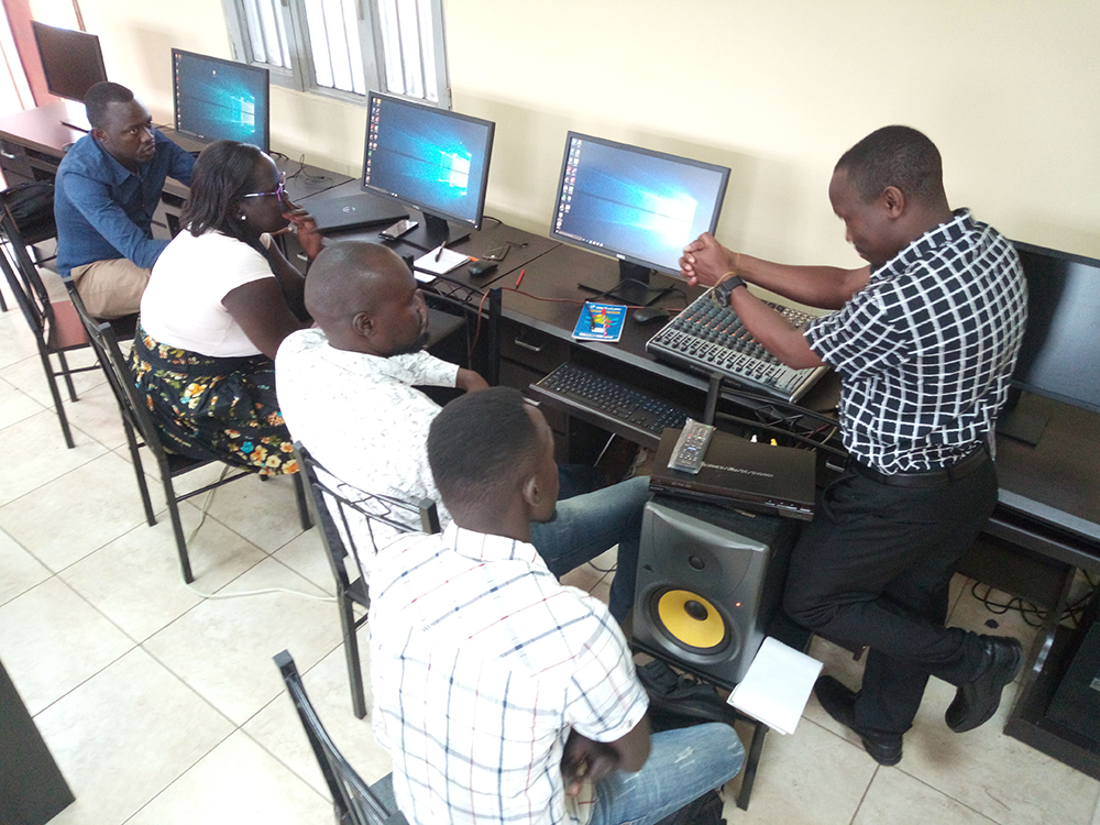 Dr. Fred Kakooza from Makerere University of Journalism and Communication training University of Juba staff in radio production in 2019.