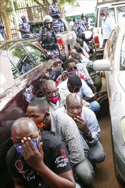Police arrest taxi operators. (Picture by Stuart Yiga)