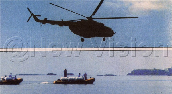 A helicopter flies over the vast Lake Victoria waters backed by aviation boats in search of survivors on October 24, 2000