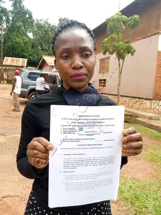 Edith Nabatanzi  Omu Booluganda  Lw'omugenzi Ekiwandiiko Kya Kkooti Ekiyimiriza Omuntu Yenna Okugula