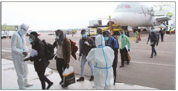 Ugandans being disinfected at Entebbe upon return aboard Qatar Airways special fl ight