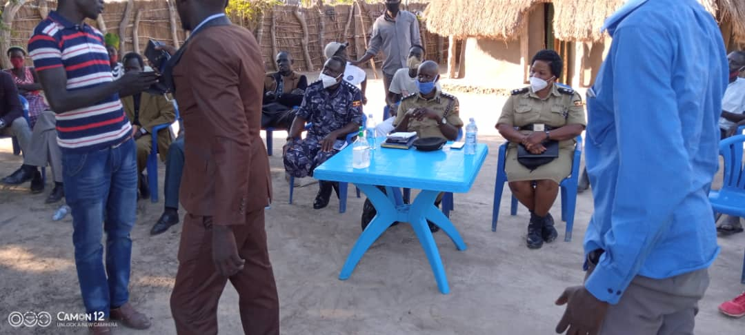Police officers convening a meeting at Rhino Camp. Photos by Uganda Police