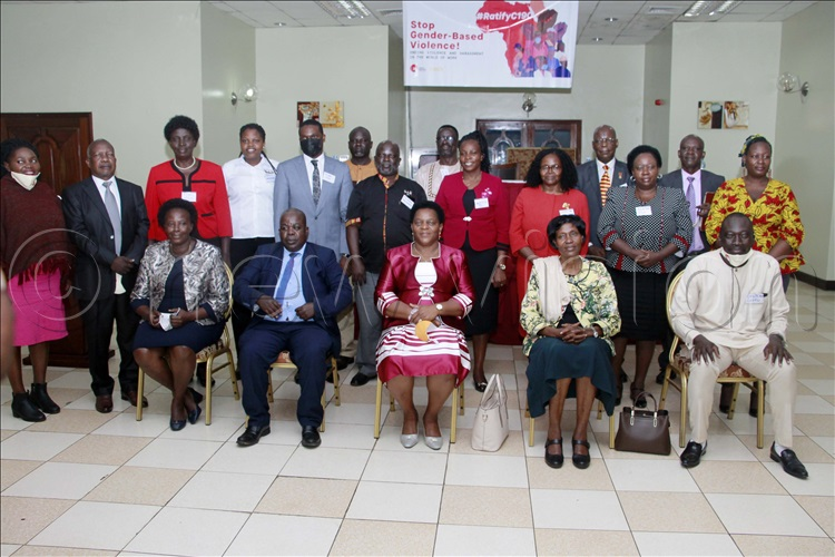 Peace Mutuuzo (seated Center), Minister of State for Gender, Labour and Social Development with other guests taking a group photo.