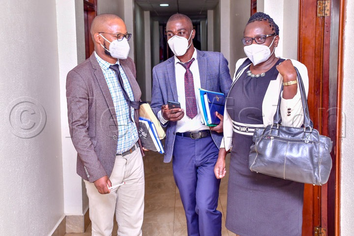 Members from Kabale hospital Sophie Namasopo(right), Hospital director , Innocent Kansiimerohanga(centre), Accountant and Rodney Tabaruka(left) after a meeting with the Public accounts committee on 13 August 2020. Photo by Miriam Namutebi