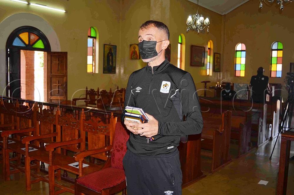 Uganda Cranes Coach Micho Milutin Sredojevic praying