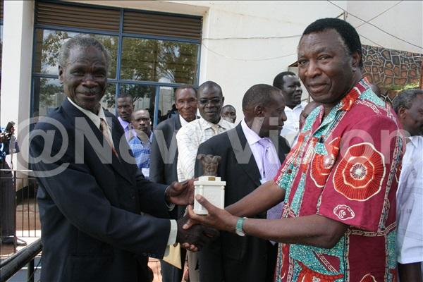 Boxing legend Grace Seruwagi receives an award from Maj. Francis Nyangweso
