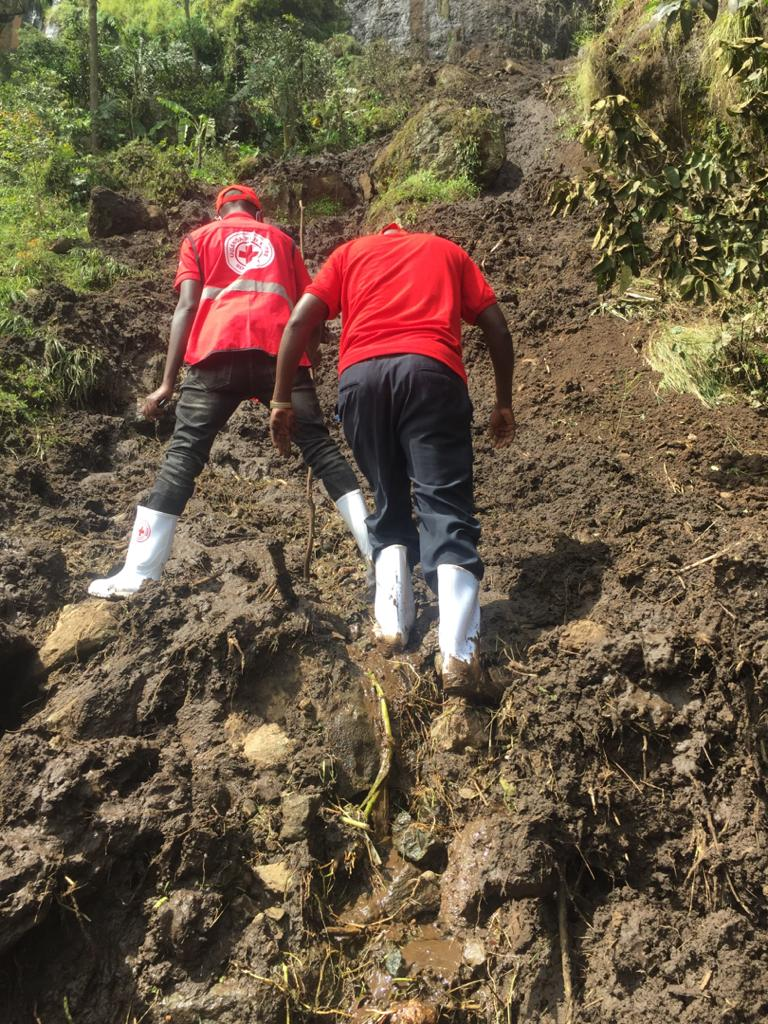 Red Cross officials assessing the affected area. Photo by URCS