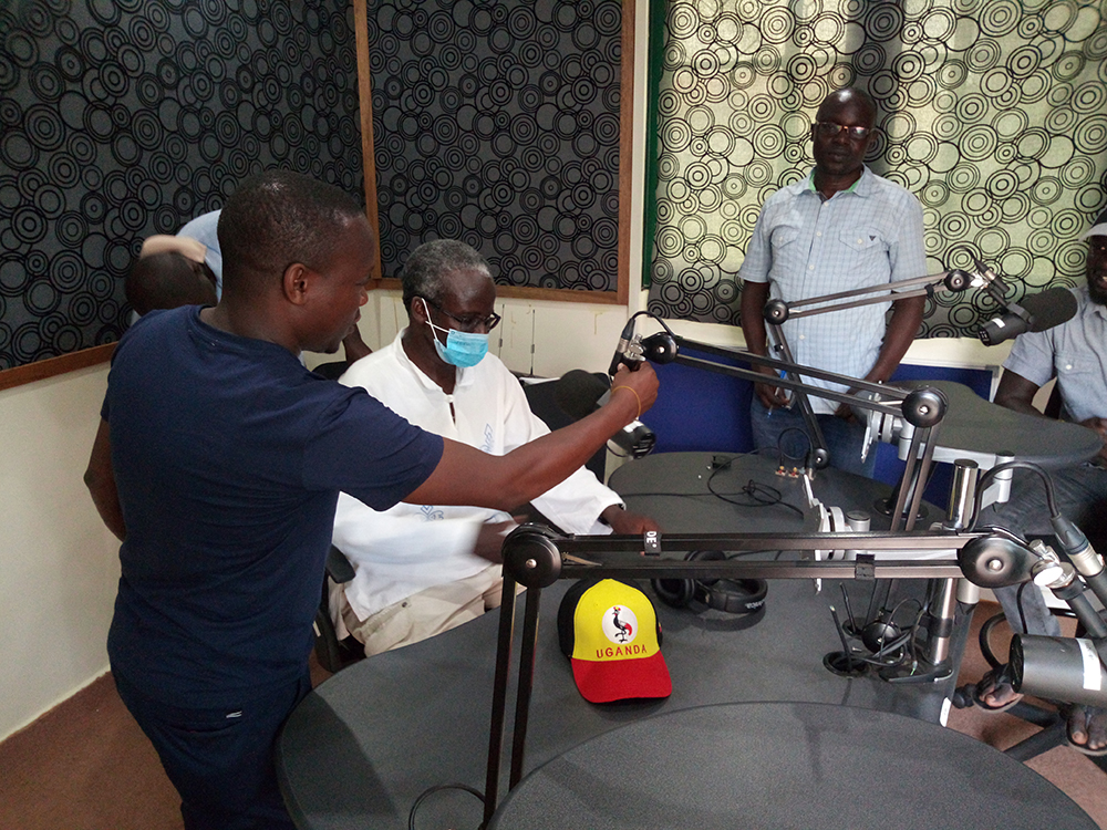 Dr. Fred Kakooza (L) adjusting a microphone for Dr. Tayeebwa in the University of Juba Radio Station in October 2020. The Makerere NOHED project team was retooling Juba staff in Multimedia production.