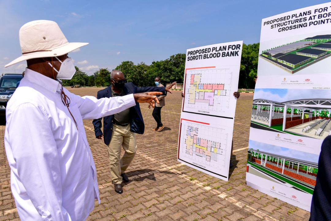 Vision Group CEO, Robert Kabushenga shows the President some of the proposed plans